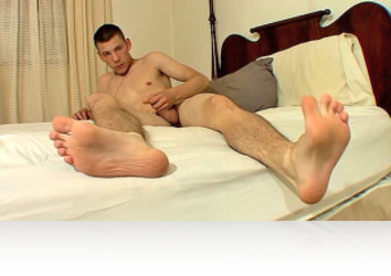 Wednesday, July 13th: We join Cooper on the bed, his big naked feet already on show and a cock getting hard in his shorts. He shows off his soles and toes and releases his dick for some jerking, getting off on watching himself in the mirror for a while before returning to the bed to pump out his hot fresh cream all over his naked foot!